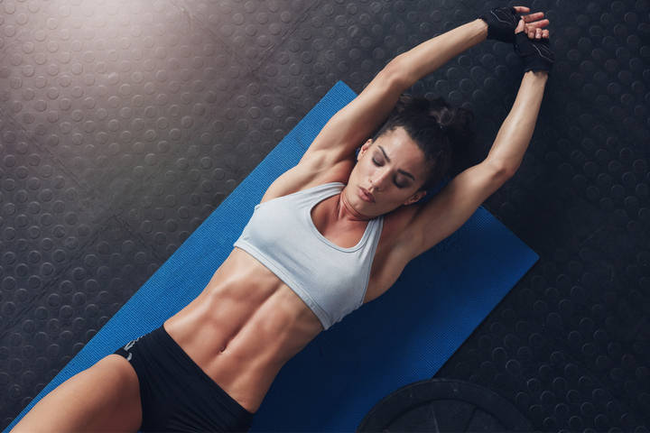 Woman doing flat belly workout